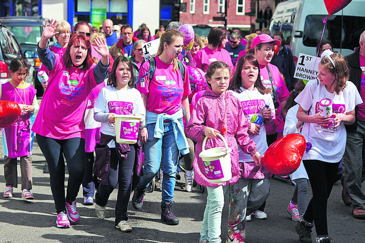 Sea of pink as town steps out to aid charity