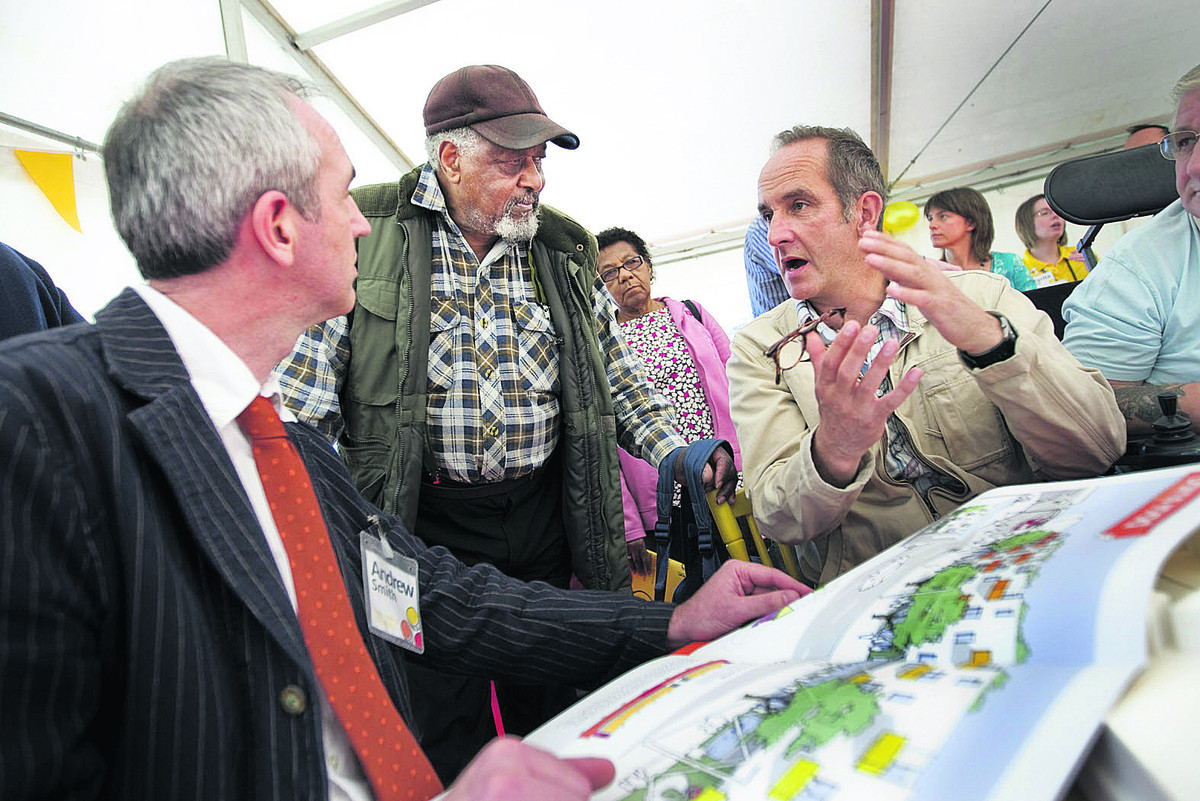 Kevin McCloud, right, with Andrew Smith of housing group GreenSquare speaking to resident Arthur Preddie about the development in 2011