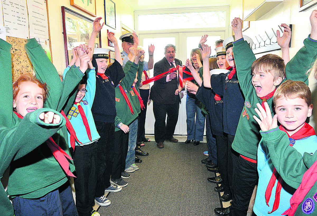 Beavers, Cubs and Scouts cheer as Sir Tony Baldry MP opens their newly refurbished headquarters