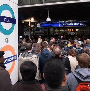 The Oxford Times: Commuters at Stratford station in east London, on the first day of a 48 hour strike by tube workers
