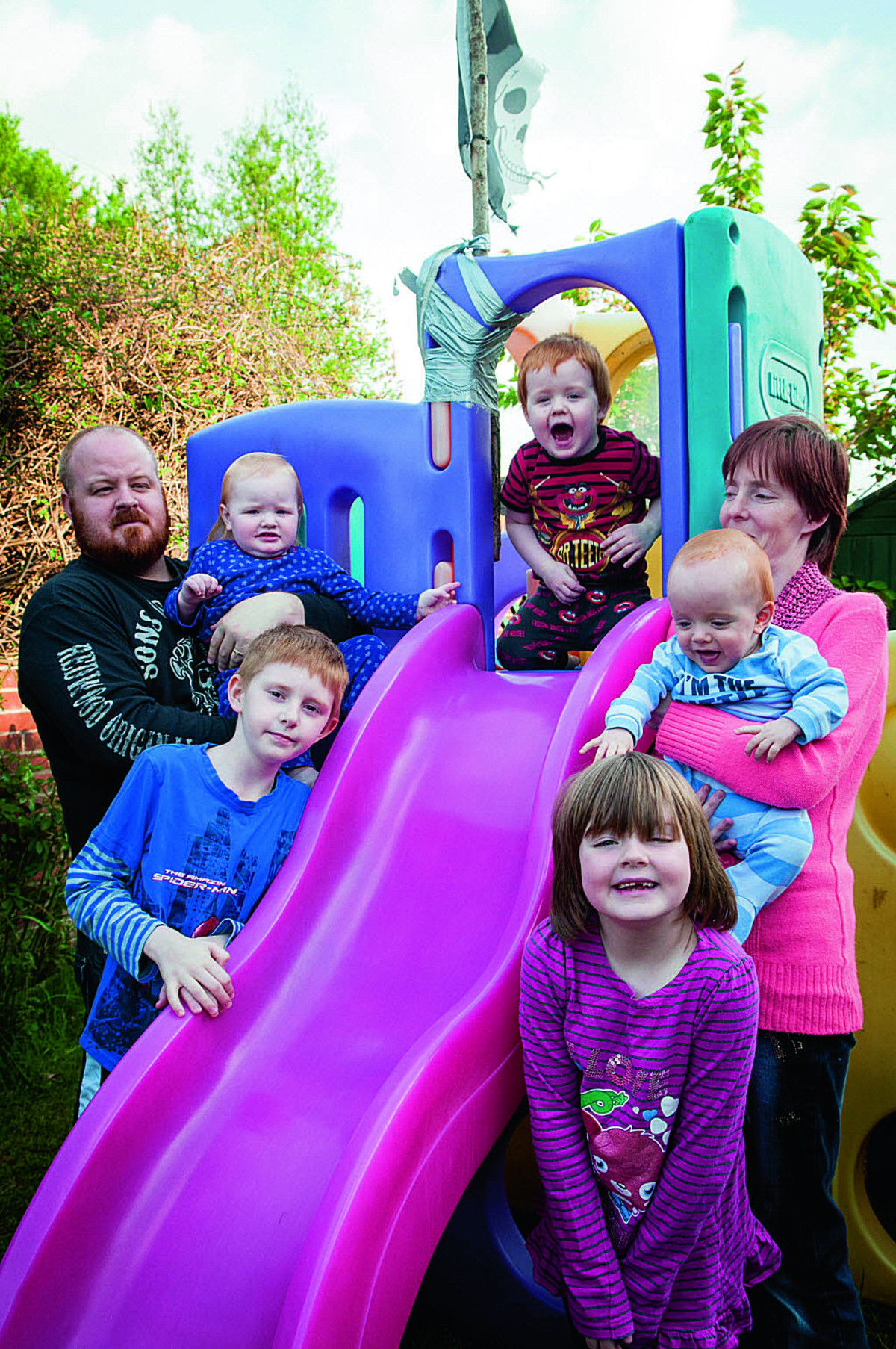 Thong Rangers help Didcot family, Jodie and Kevin Frankum and their five children. Left, Kevin holding 19-month old Kacey, with Brendon, eight. Centre, Tye, two. Right, Jodie with Leah, seven, and Tommy, 10 Months