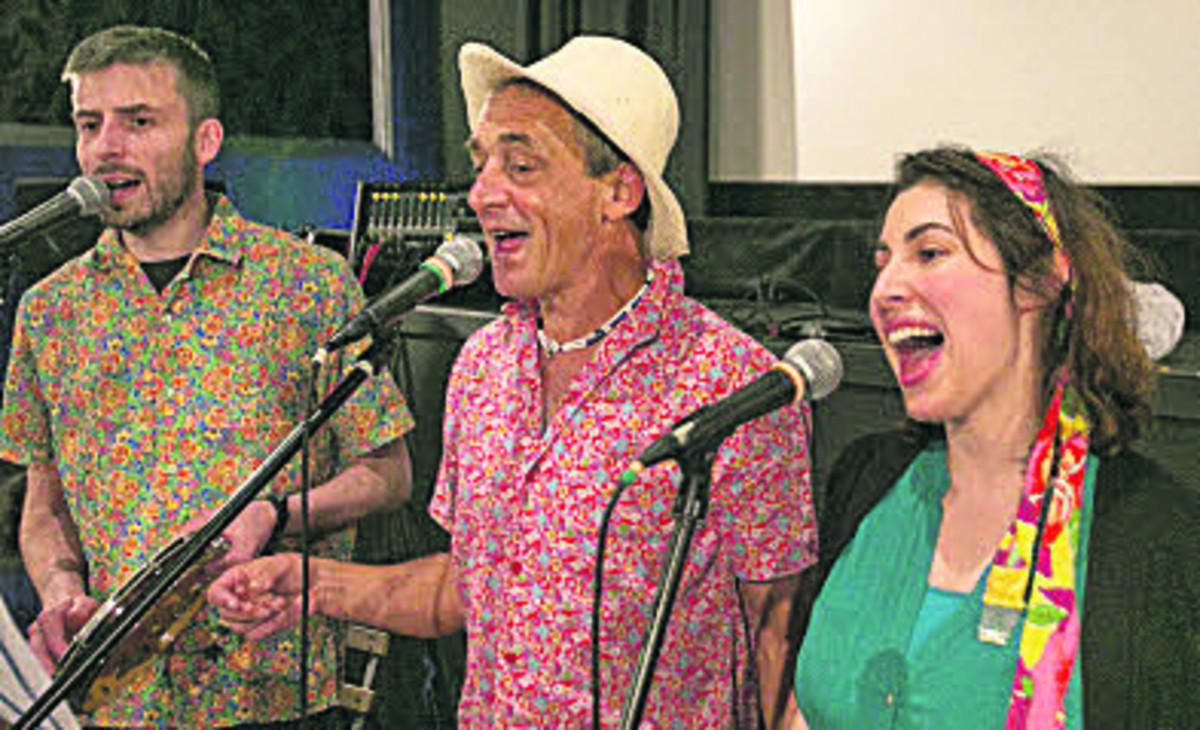 The Illustrious Sambistas, from left, John Appleby, Peter Williams and Melissa Akdogan perform at the carnival fundraiser