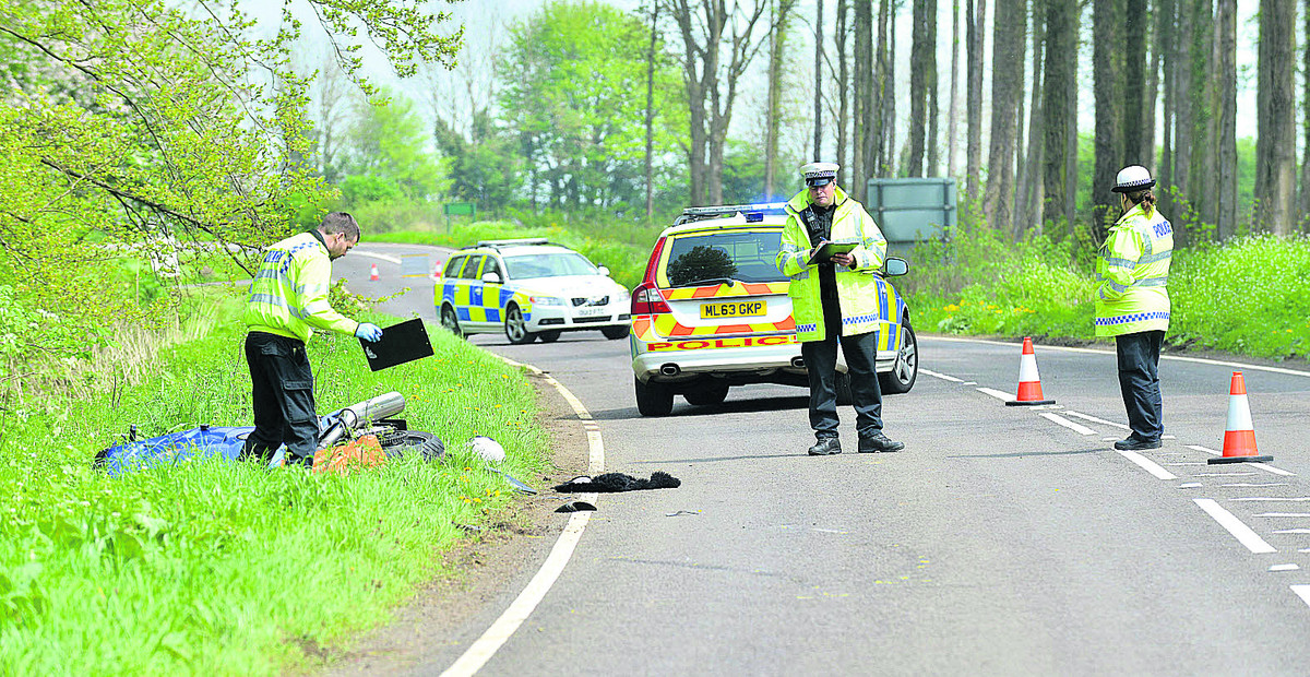 Police at the scene of the motorcycle crash on the A361 near Swerford
