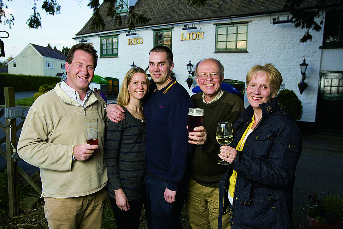 From left, Stuart Cope, Lisa Lyne, Ian Neale, Graham Shelton and Helen Hutchings outside the Red Lion in Northmoor, which has saved by the community