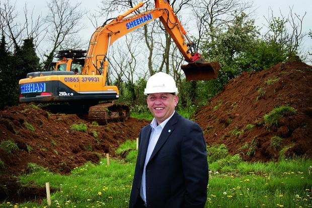 The Oxford Times: Project director Steve Hornblow watches bulldozers start work on the eco town