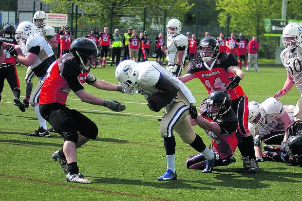 Mike Oluwole blasts through to give Oxford Saints their first touchdown in the 19-6 win at Lincolnshire Bombers  Pictures: Chris Janes