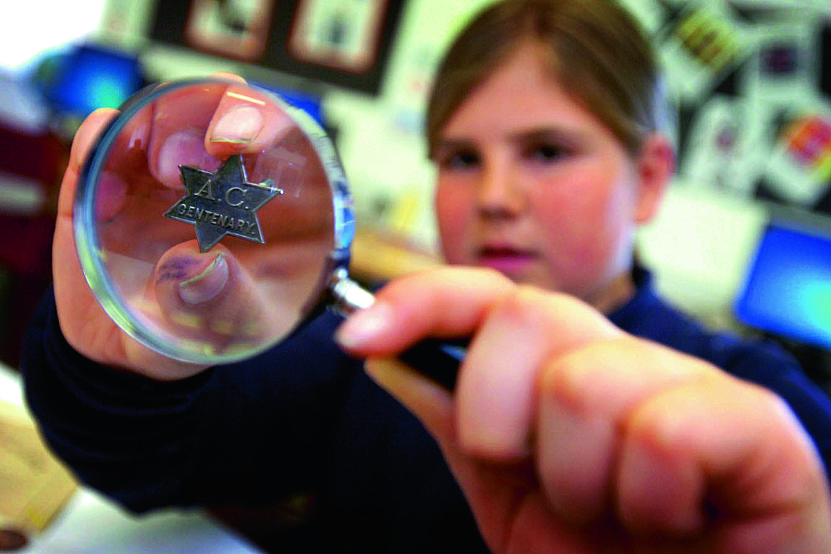 Marlborough School pupil Emma Stringer, 13, looking at the AC Star of David centenary badge found in the time capsule.  Picture: