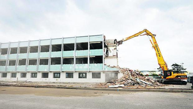 DEMOLITION JOB: One of the large office blocks alongside the Eastern bypass at the BMW car pl