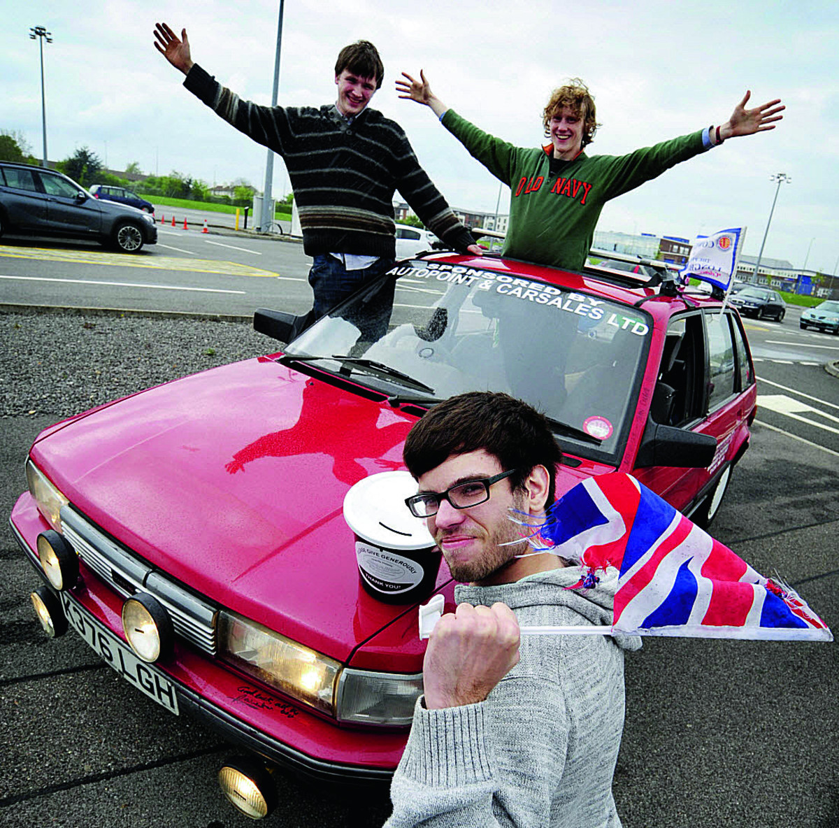 From left, Guy Laister, 20, Zac Coleman, 19, and front David Tapping, 21, with their 1992 Austin Maestro.  Main picture: David Fleming