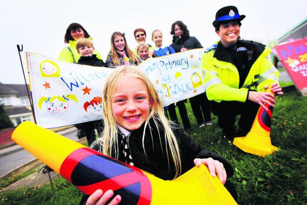 Ruby Clarke, eight, front, and PCSO Fiona Holt. Picture: OX66862 Ed Nix