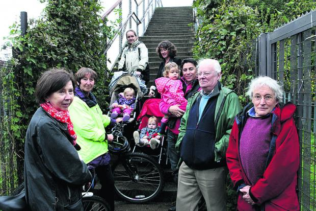 The Oxford Times: BATTLE: Residents who have been campaigning for the bridge to have ramps
