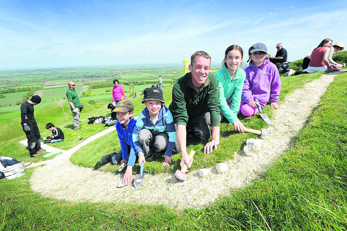 White sutff: National Trust ranger Andy Foley with, from left, Aidan Slark, nine, Thomas Robinson, eight, Abbie and Jodie Slark, 11 and seven respectively