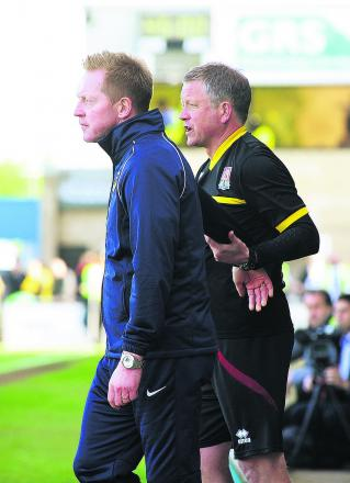 Gary Waddock and Chris Wilder exchange words just before full time on Saturday