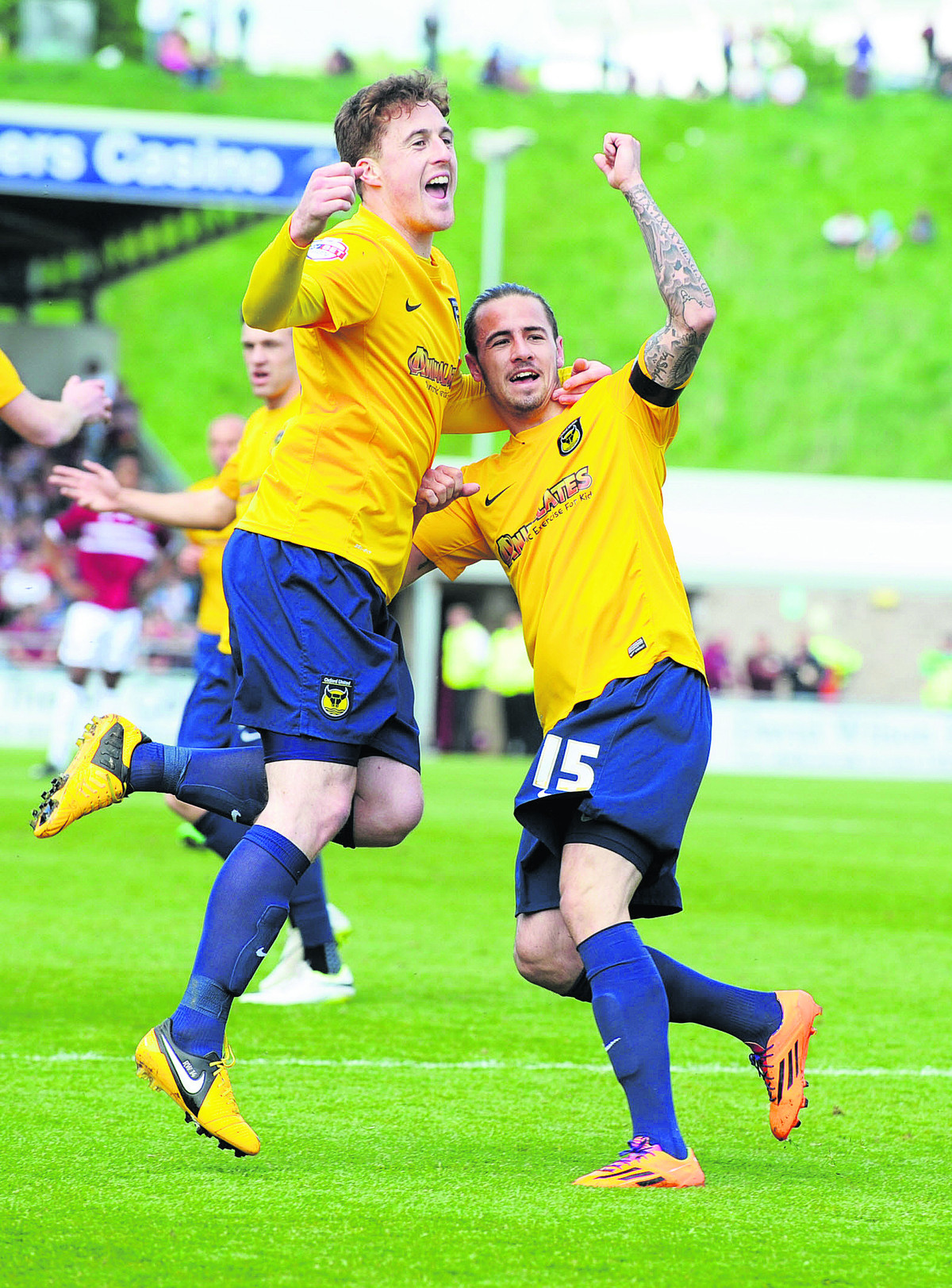 Scott Davies celebrates Ryan Williams's early goal for Oxford, before things went bad for the winger, who was shown a red card for kicking out at Northampton's Ricky Ravenhill