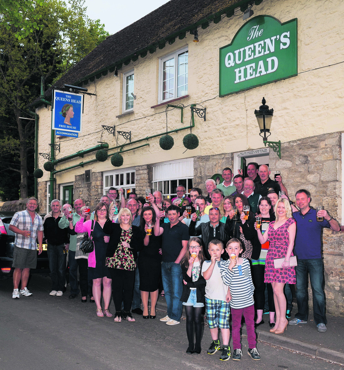Customers of The Queen's Head raise a glass to Stan Hawkeswood's swift return  including his eldest grandson, Jamie Farrell, eight