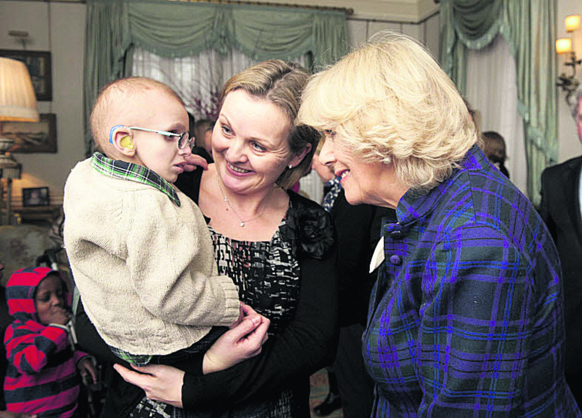 LEGACY PLEDGE: Thomas Laurie, held by his mother Catherine Laurie, met the Duchess of Cornwall in 2012