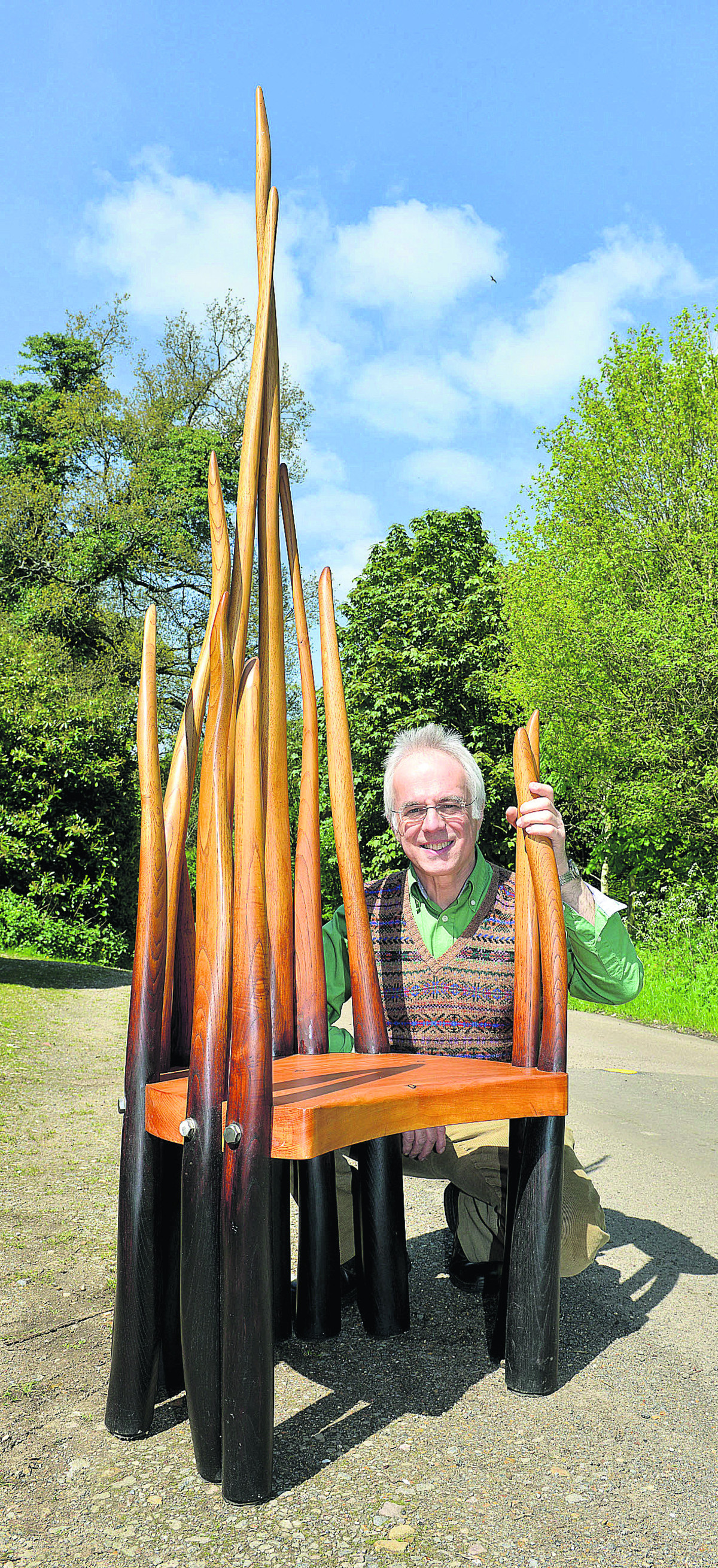 Philip Koomen with his pondlife bench which is made from a sweet chestnut tree found in Bagley Wood. Picture: OX66985 Simon Williams
