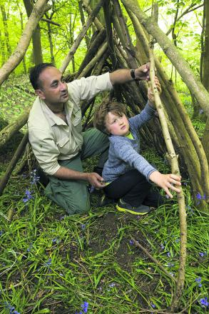 Manse Ahmad teaches Francis Garcia Shapley how to build a shelter        Picture: OX66981 Antony Moore