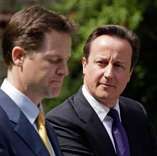 Prime Minister David Cameron, right, and Deputy Prime Minister Nick Clegg must agree on rules fo