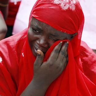 A woman attends a demonstration in the Nigerian capital Abuja calling on the government to rescue the kidnapped school girls (AP)