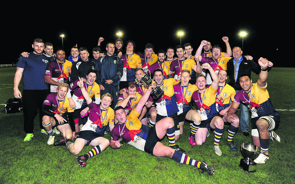 Oxford Harlequins' players and officials celebrate their cup success