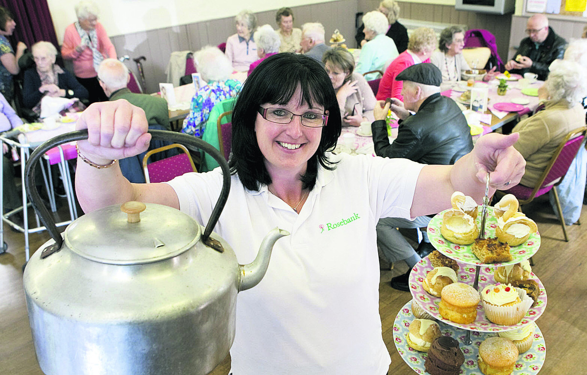 Mandie Acock pours as Rosebank Care Home visitors take tea in Bampton.  Picture: OX67030 Antony Moore