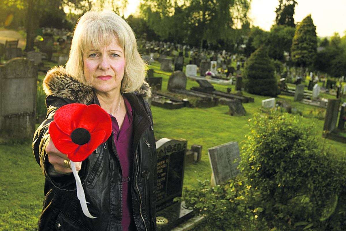 Susan Nicholls at the grave; below, Lance Corporal Michael Hall. Picture: OX66841 Antony Moore