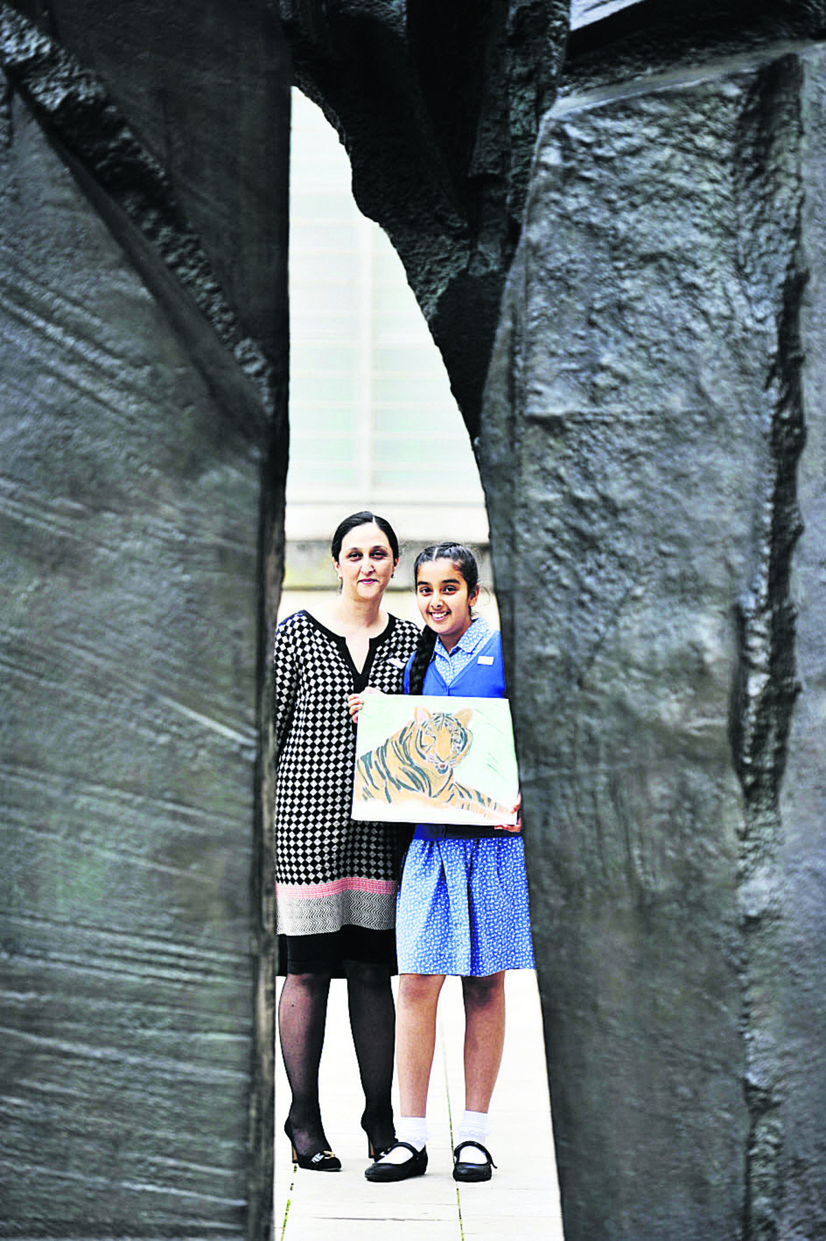 Oxford High School pupil Navica Jangra, 10, with her mum Shelly Jangra and her painting entitled Chilling Tiger