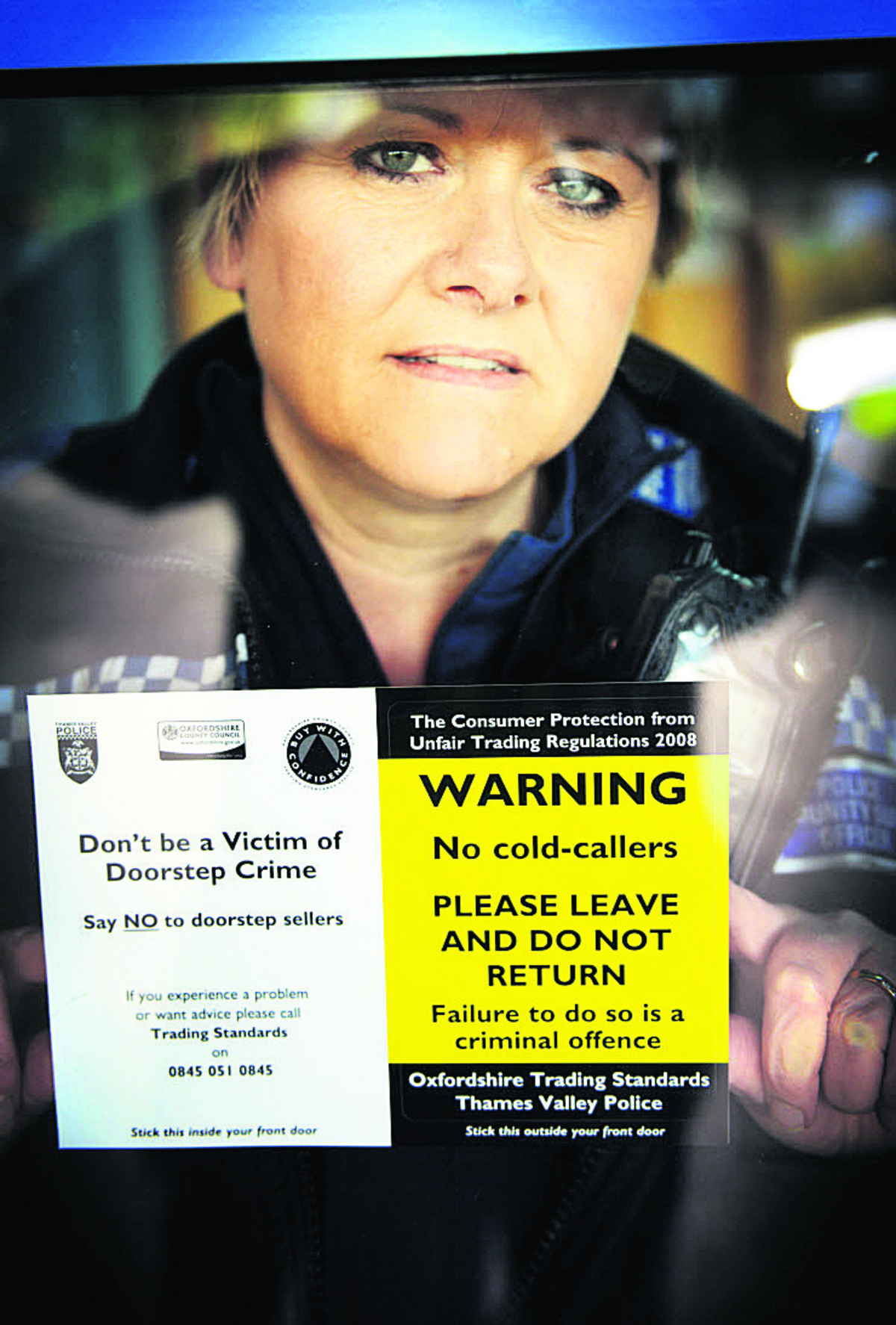 Pcso Helen Keen at Eynsham police station with window stickers, hoping to raise awareness of the new scheme to protect the vulnerable