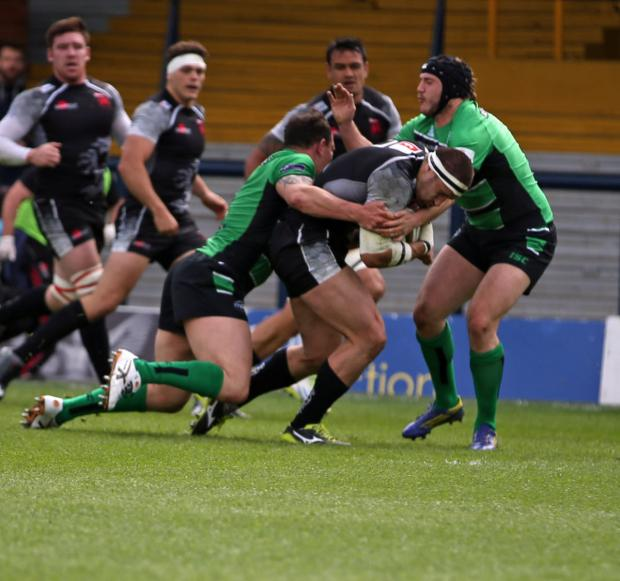 The Oxford Times: London Welsh's Carl Kirwan drives at the Leeds Carnegie defence during the first leg defeat