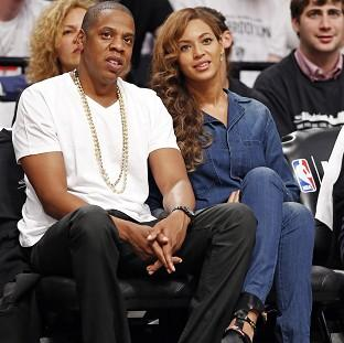 The Oxford Times: Jay-Z and his wife Beyonce, watching a basketball game in New York, hours after the video leak (AP)