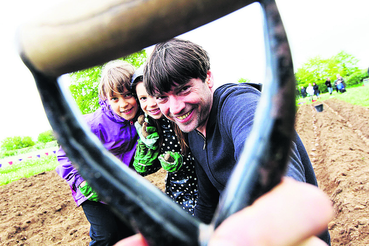 Alex James with Zoe Lamb, nine, pictured left with Emily Jones, six. Picture: OX67123 Ed Nix
