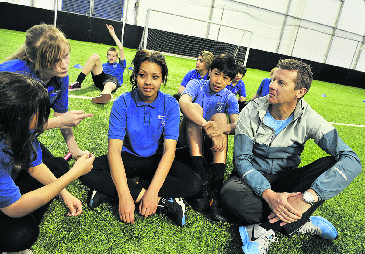 Steve Cram, right, talks to, from left, Courtney Bowler, 14, Shannon Ewers, 15, Destiny Crawford Giles,15, and Bruce Nheu Lay, 15. Picture: OX67163 Mark Hemsworth