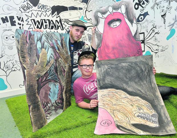 Illustrator Luke Daniels and Frazer Cruickshank, 12, with his Little Red Riding Hood artwork Picture: OX67173 Simon Williams