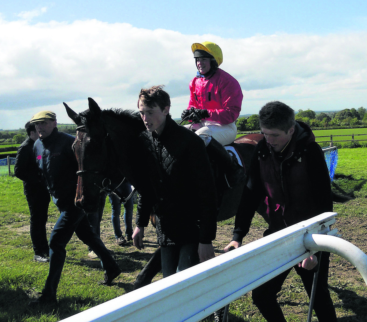 Ravethebrave and jockey Hannah Watson return to the winner's enclosure flanked by Alan Hill, with cap, stable lad Tom Kindleyside and his Joe Hill, right, who is on crutches nursing a broken ankle