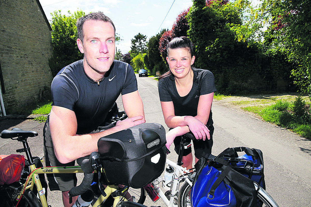 Jason and Jessica Powell are cycling all the way to Australia