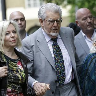 The Oxford Times: Rolf Harris arrives with his family at Southwark Crown Court in London (AP)