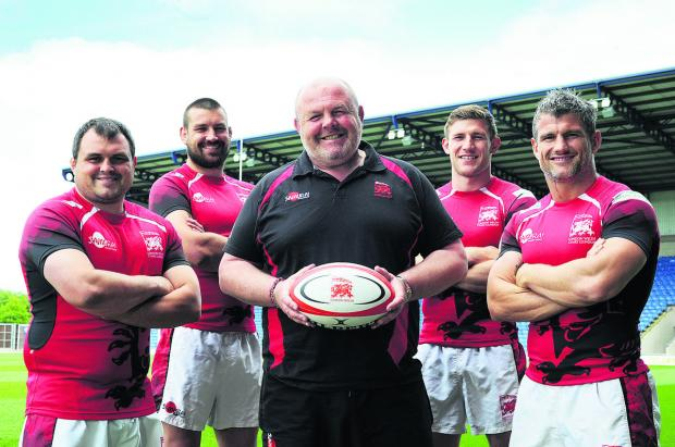 The Oxford Times: London Welsh at their pre-match press conference at the Kassam Stadium yesterday ahead of their Greene King IPA Championship play-off semi-final. From left: Nathan Trevett, Matt Corker, head coach Justin Burnell, Alan Awcock and Tom May