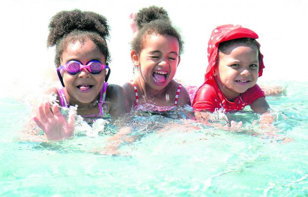 From left, Xiomara Wellington-Faissal, six, Naomi Paton, three, and Zephaniah Wellington-Paton, three, enjoyed Oxfordshire's hottest day by taking a dip at Oxford's Hinksey Pool yesterday