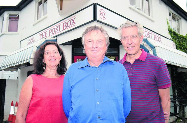The Oxford Times: Alison Morris, Steve Lunn, centre, and Phillip Dove from Wolvercote Community Benefit Society outside the shop