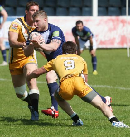 Alex Thompson on the way to one of his two tries for Oxford