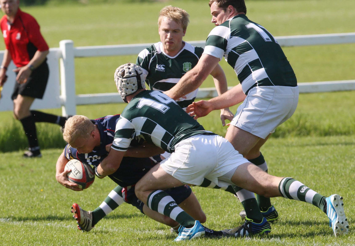 Oxfordshire's Zac Norris forces his way over for the winning try against Dorset & Wilts