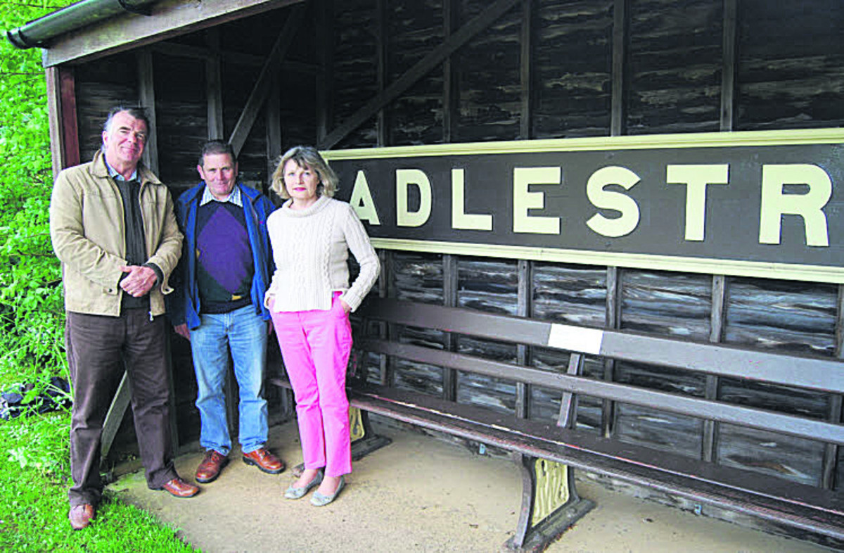 From left, Gordon Harris, chairman of the committee co-ordinating the centenary celebrations, committee member Ralph Price, whose father was the last stationmaster at Adlestrop, and Victoria Huxley at the village's bus shelter