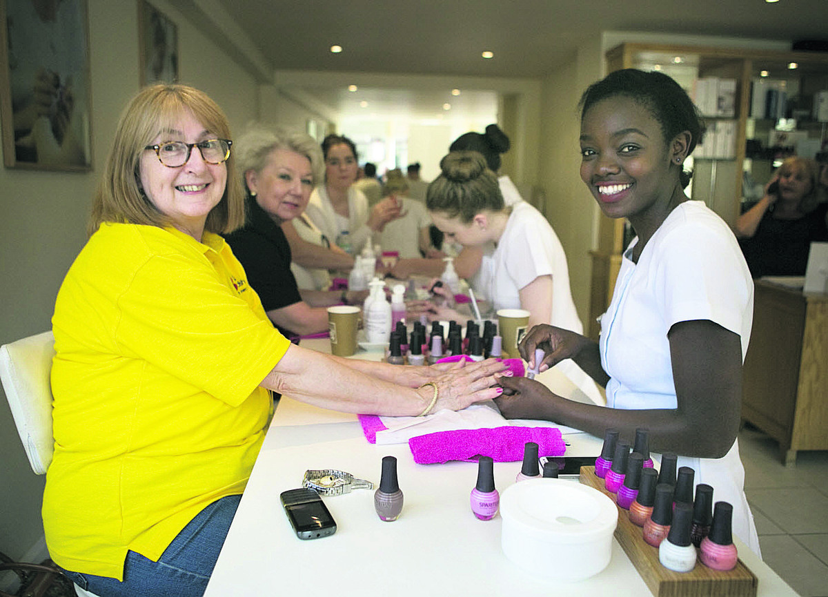 Anney Harris, left, has her nails painted by Vania Neeve. Picture: OX67028 Antony Moore