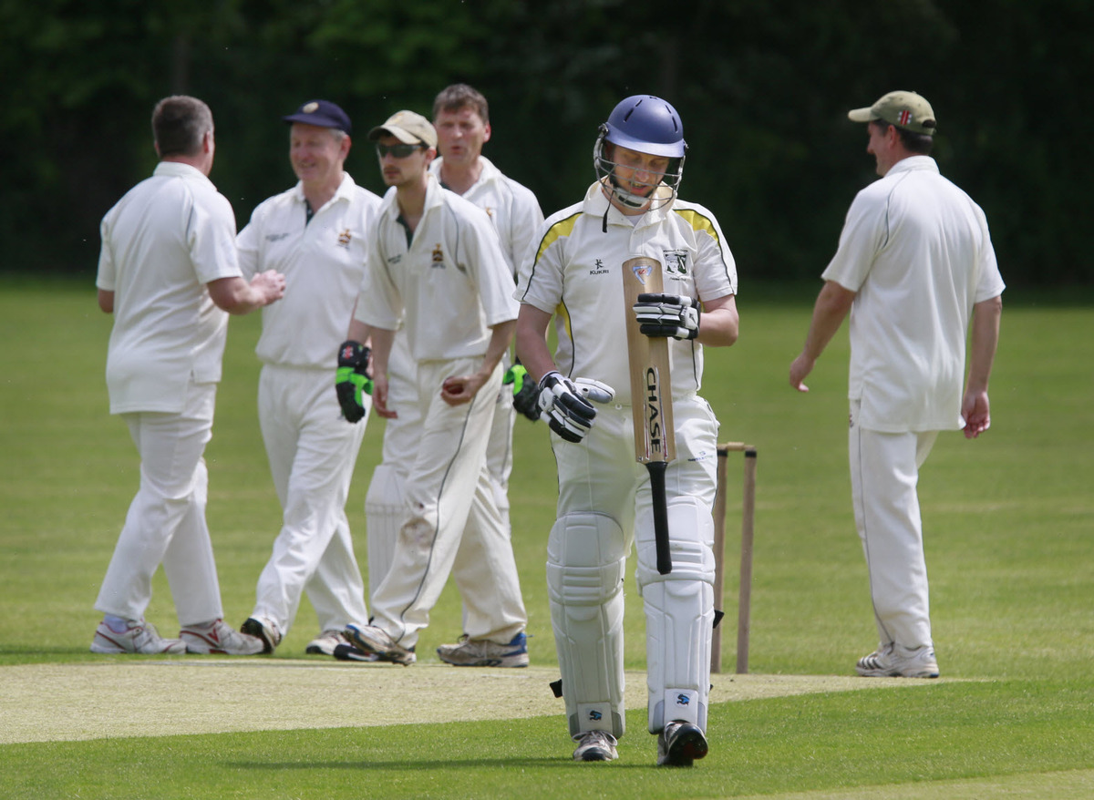 Wantage's Richard Chapman pointedly looks at his bat after being given out lbw against Fringford