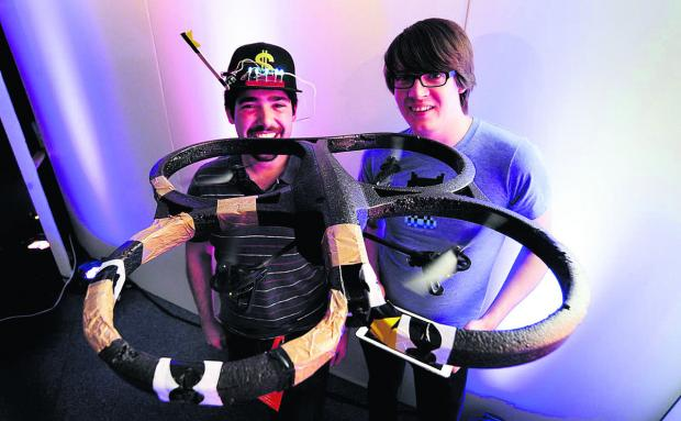 The Oxford Times: Francis Gulotta, left, and Andrew Nesbitt, with one of their flying robots which can be operated by a hoodie