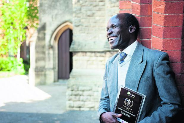 The Oxford Times: Henry Chitsenga with his Lifetime Outstanding Contribution award in the Zimbabwe Achievers Awards