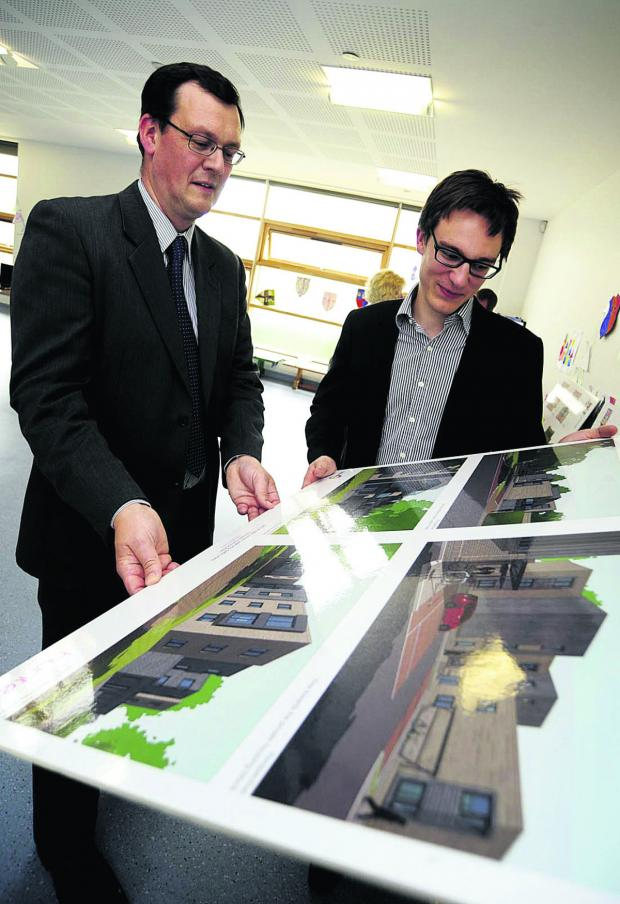 The Oxford Times: Graeme Jackson, left, and architect Morgan Parrack discuss the plans for affordable housing on the site of boarded-up Marywood House Picture OX67365 David Fleming