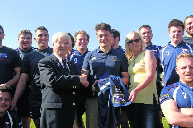 Oxfordshire RFU president Ken Bumpass receives a county shirt sponsored by the Jim Douglas Memorial Fund from the late Harwell player's son Rob (centre) and partner Mandy Evans. It was the Douglas family's wish to support Oxfordshire rugby and put the
