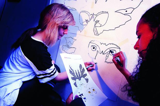 Isis Howes, left, and Leigh Bayley are showing off their artistic talents